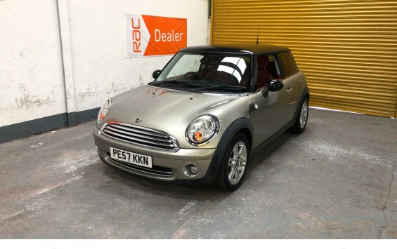 2007 Mini Cooper in champagne silver metallic & £4,800 worth of extras and a red leather interior